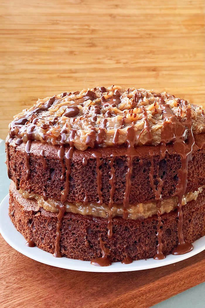 Easy Homemade German Chocolate Cake With Cake Mix on White Plate With Wood Background