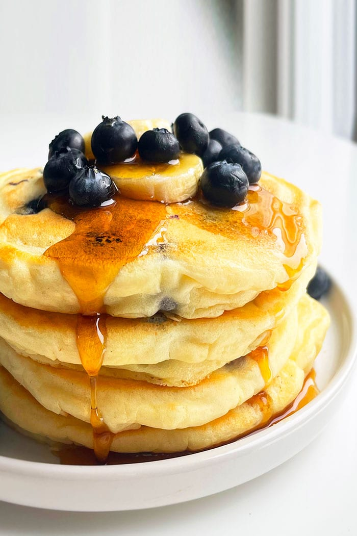 Stack of Best Fluffy Pancakes With Blueberries on White Plate