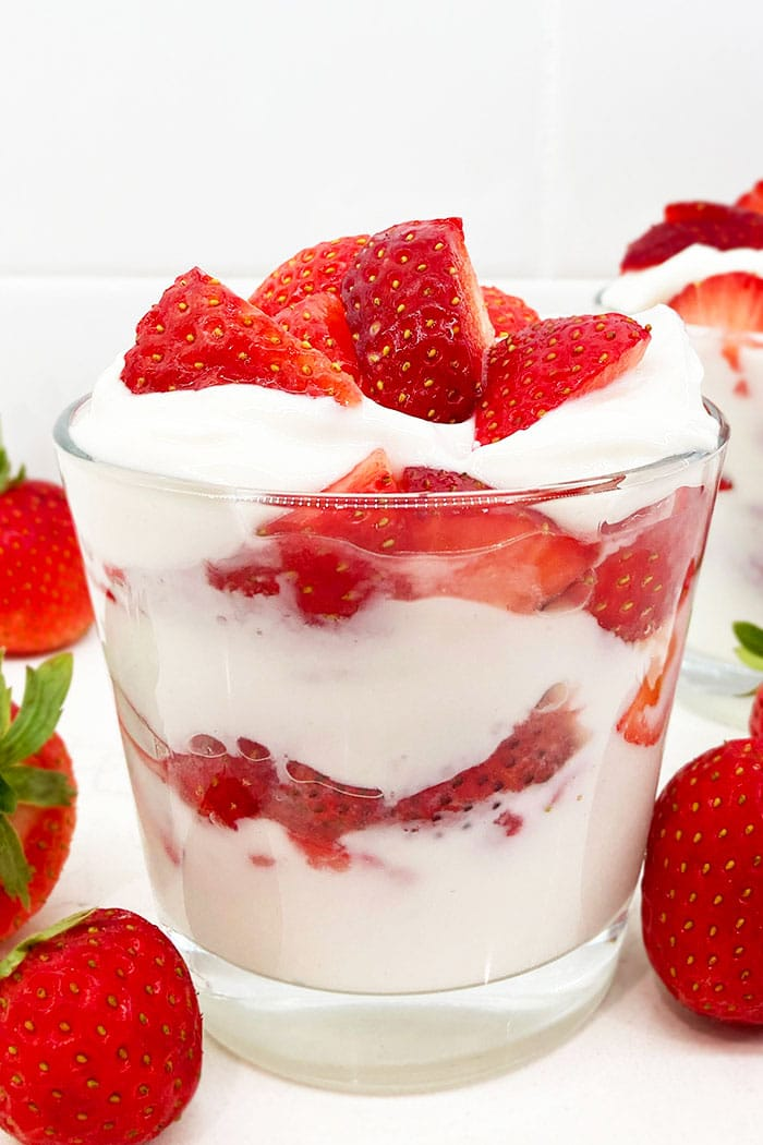 Easy Strawberries and Cream in Glass Cup With White Background