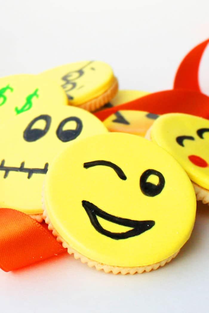 Fondant Decorated Emoji Oreo Cookies on White Background