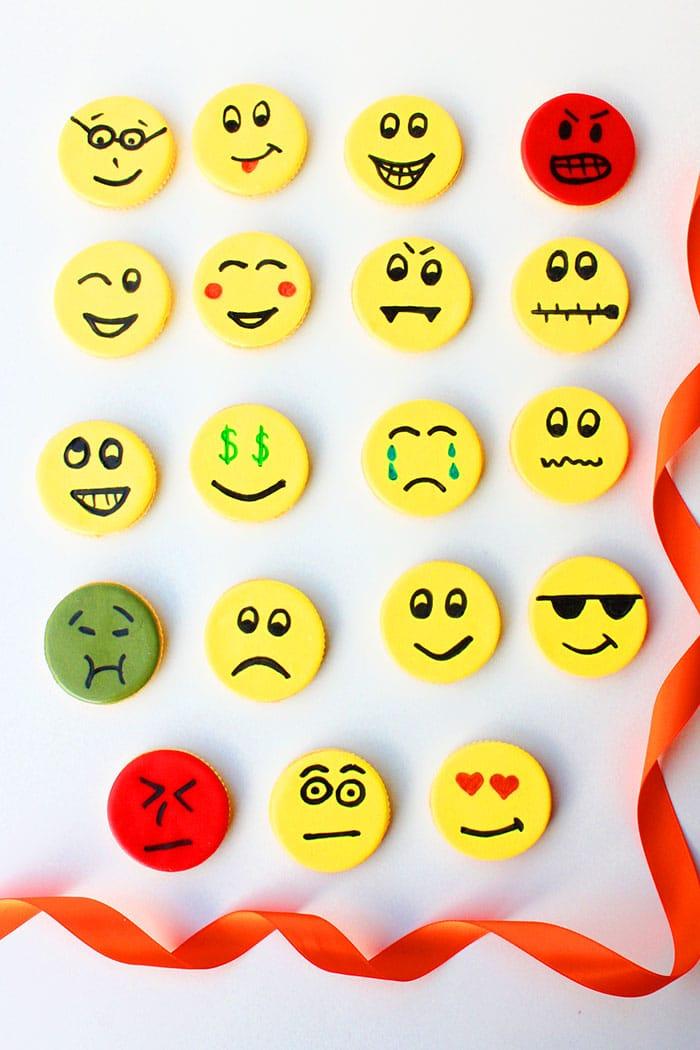 Variety of Easy Emoji Cookies Displayed on White Background
