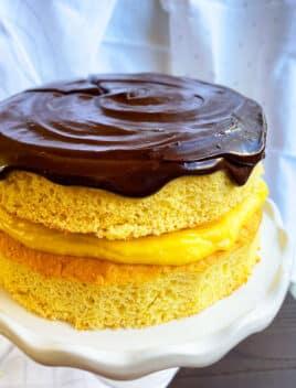 Easy Boston Cream Pie on White Cake Stand