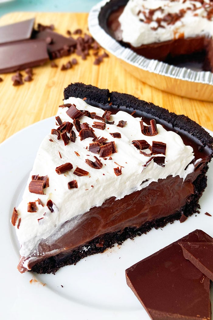 Slice of Homemade Chocolate Pie With Pudding in White Plate