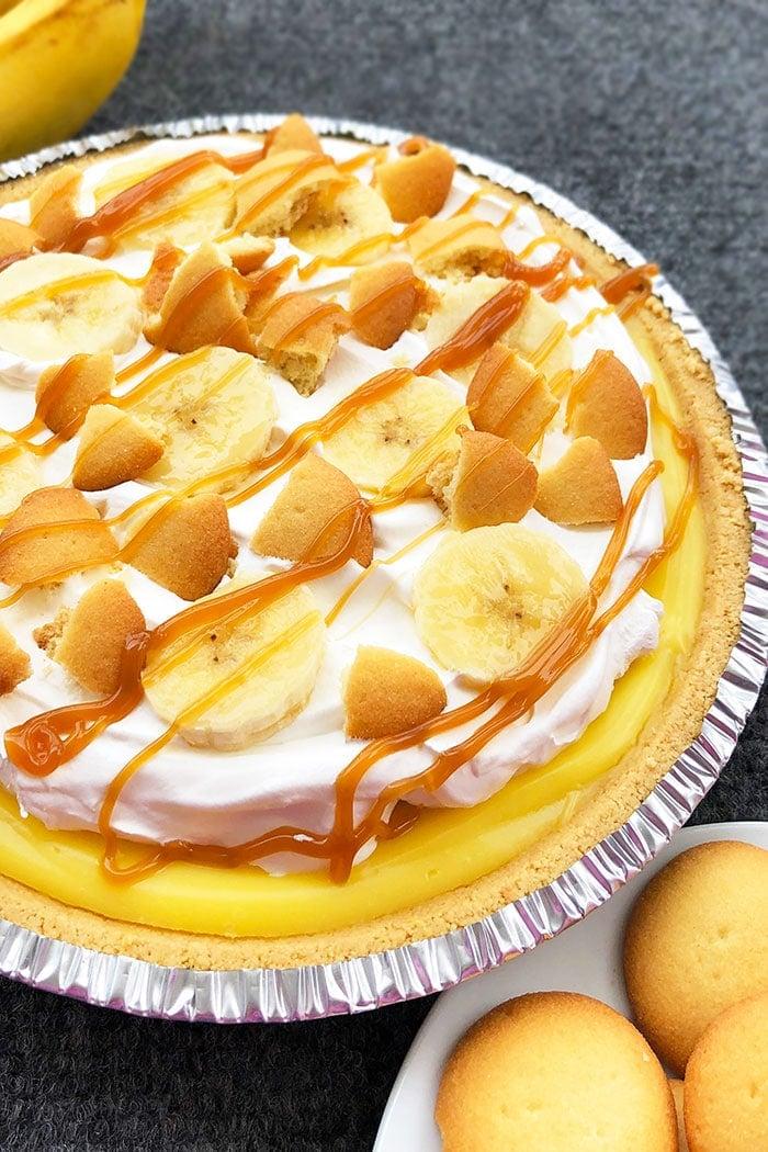 Easy No Bake Banana Cream Pie on Gray Background