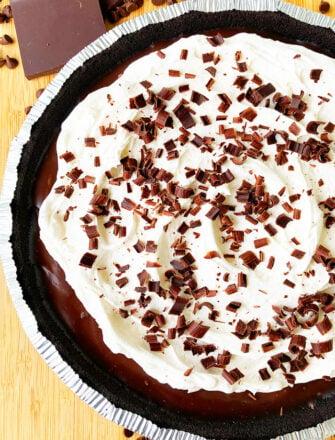 Easy No Bake Chocolate Cream Pie With Oreo Crust on Wood Background