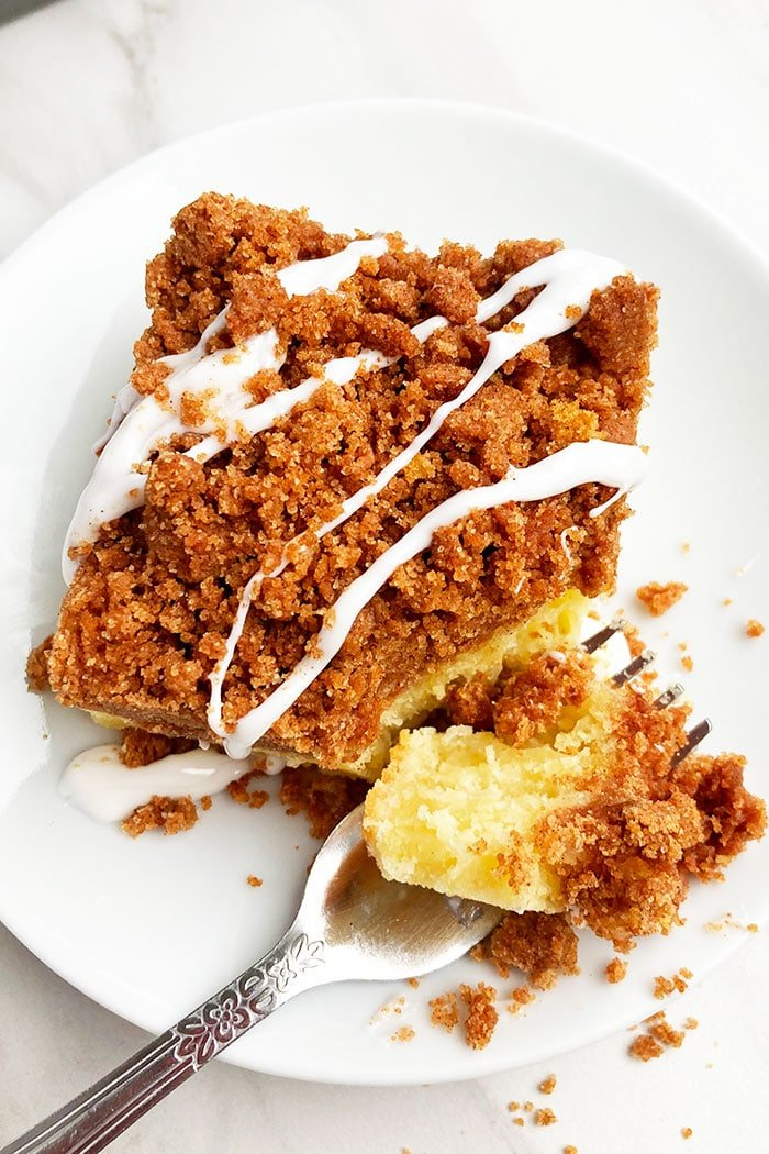 Slice of Crumb Coffee Cake in White Plate