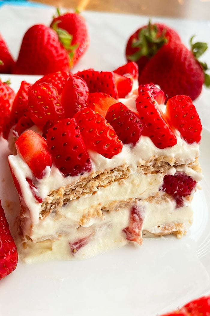 Slice of Traditional No Bake Refrigerator Cake With Strawberries on White Plate