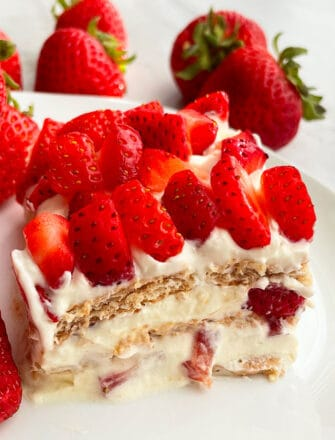 Slice of Old Fashioned No Bake Icebox Cake With Strawberries on White Plate