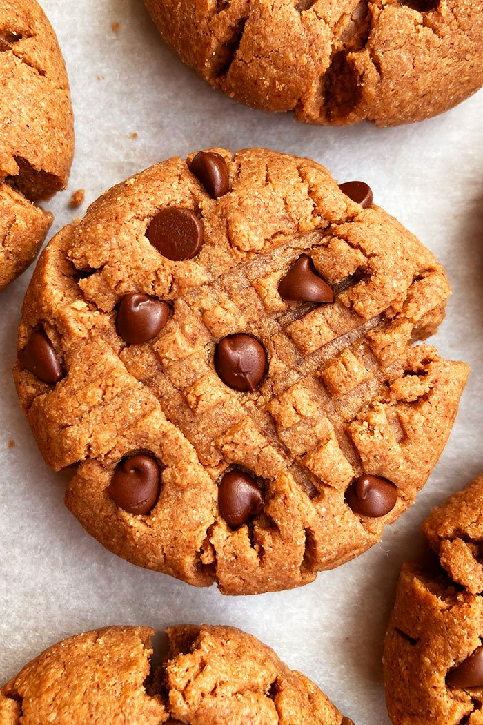 Easy Chocolate Peanut Butter Cookies on White Parchment Paper- Overhead Shot