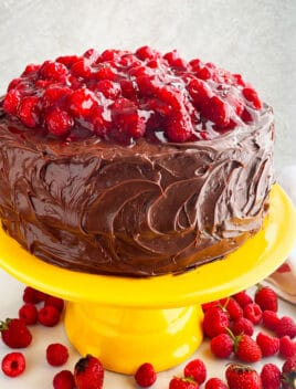 Easy Chocolate Raspberry Cake With Ganache Frosting on Yellow Cake Stand