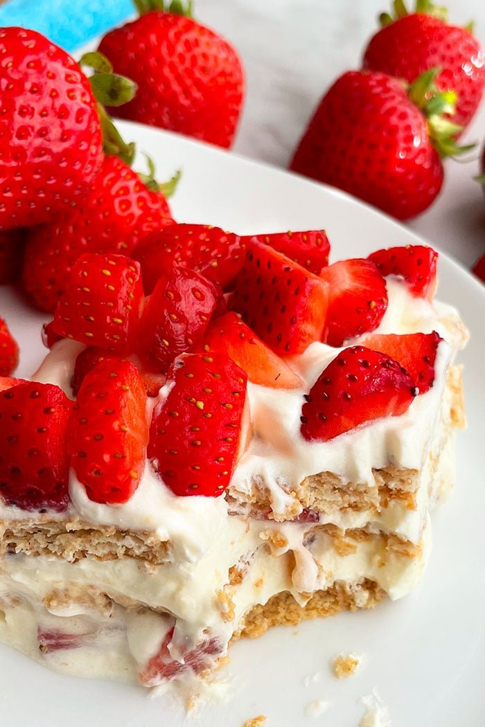 Slice of Easy No Bake Cake With One Spoonful Removed