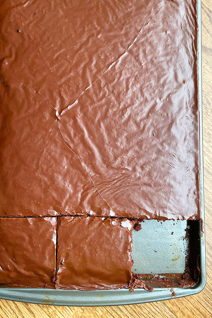 Easy Texas Chocolate Sheet Cake With Buttermilk in Half Sheet Pan With One Slice Removed- Overhead Shot