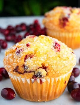 Quick, Soft, Fluffy, Easy Cranberry Orange Muffins on White Background