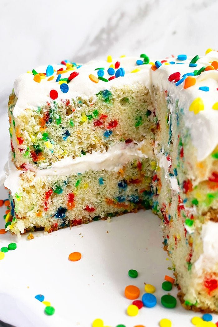 Homemade Confetti Cake With One Slice Removed and Inside Exposed