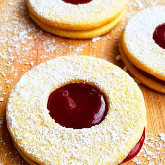 Easy Linzer Cookies Sandwiches With Raspberry Jam on Wood Background
