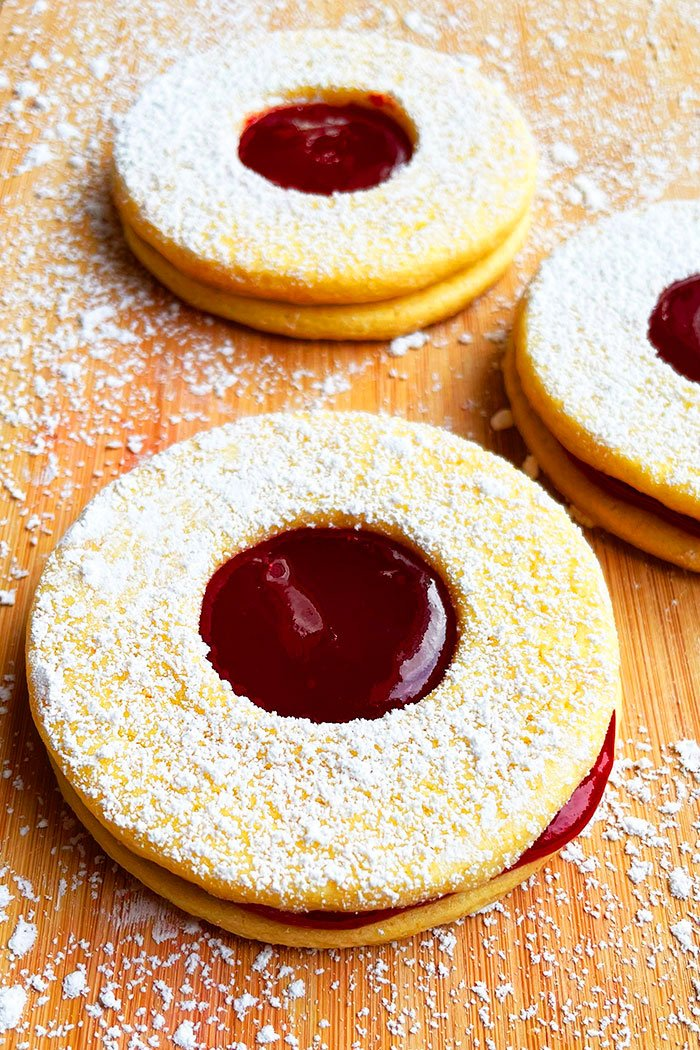 Easy Linzer Cookies With Raspberry Jam on Wood Background