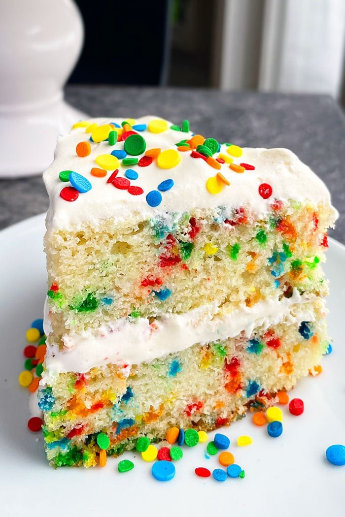 Easy Yellow Cake With Sprinkles on White Plate