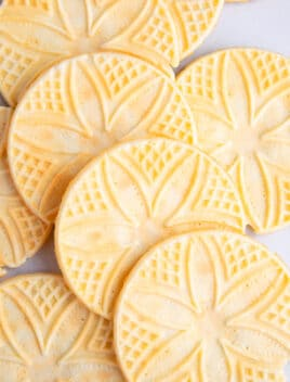 Closeup Shot of Lots of Italian Pizzelle Cookies on White Background